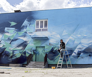 Street Artist Transforms Building Façade With Bold Strokes of Colorful Energy